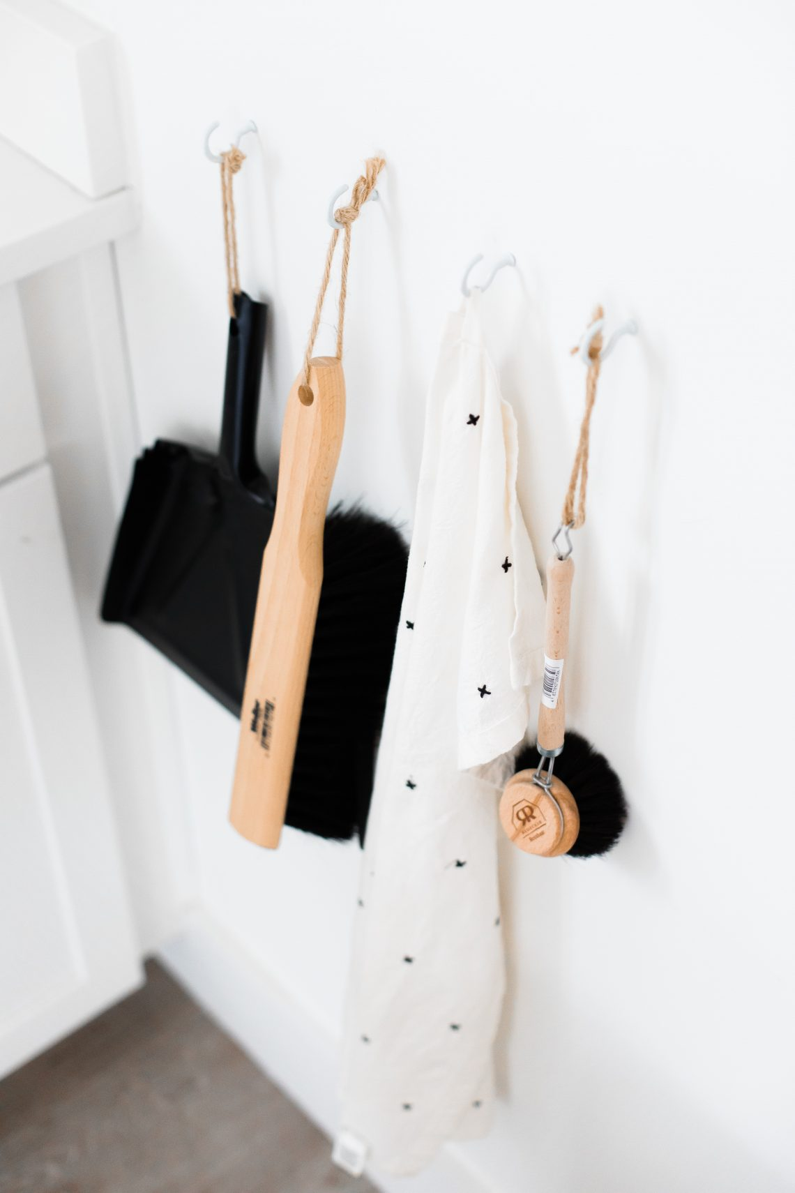 three black and brown bathroom cleaning tools