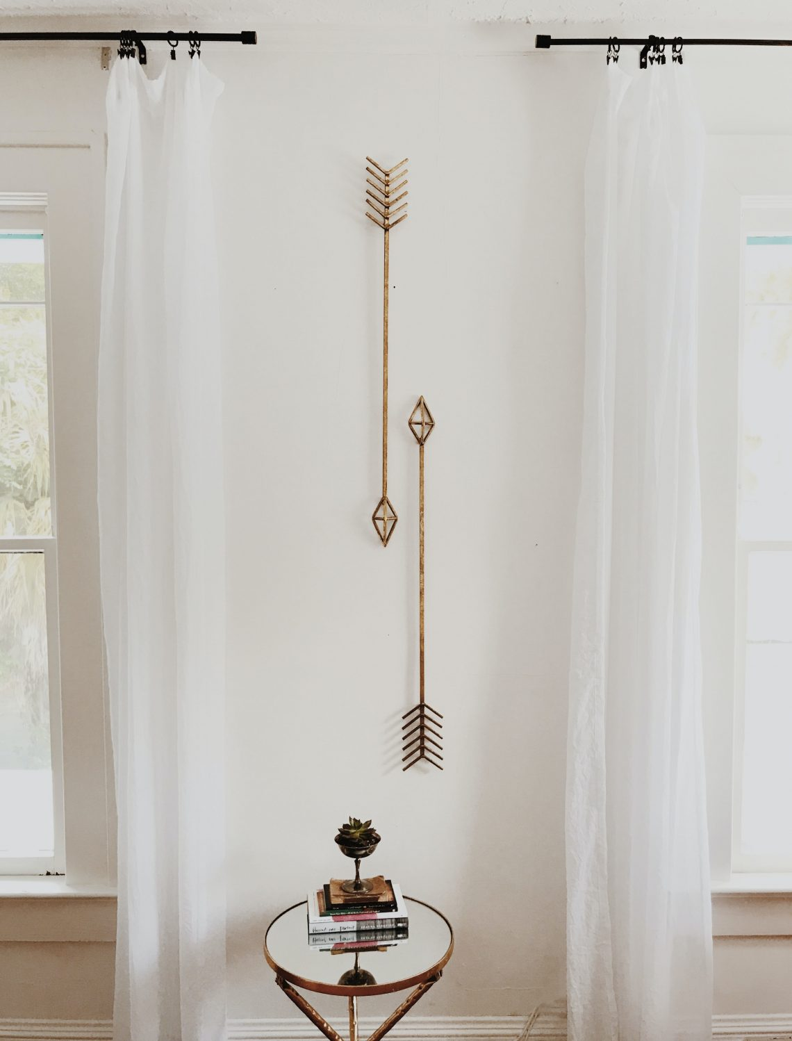 brown wooden cross on white wall