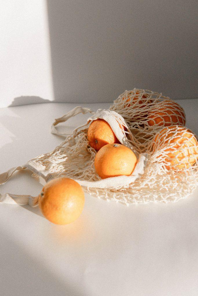 orange fruits on white net