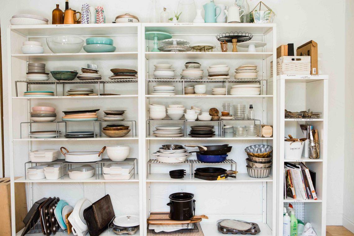 assorted ceramic dinnerware set displayed in white wooden shelf