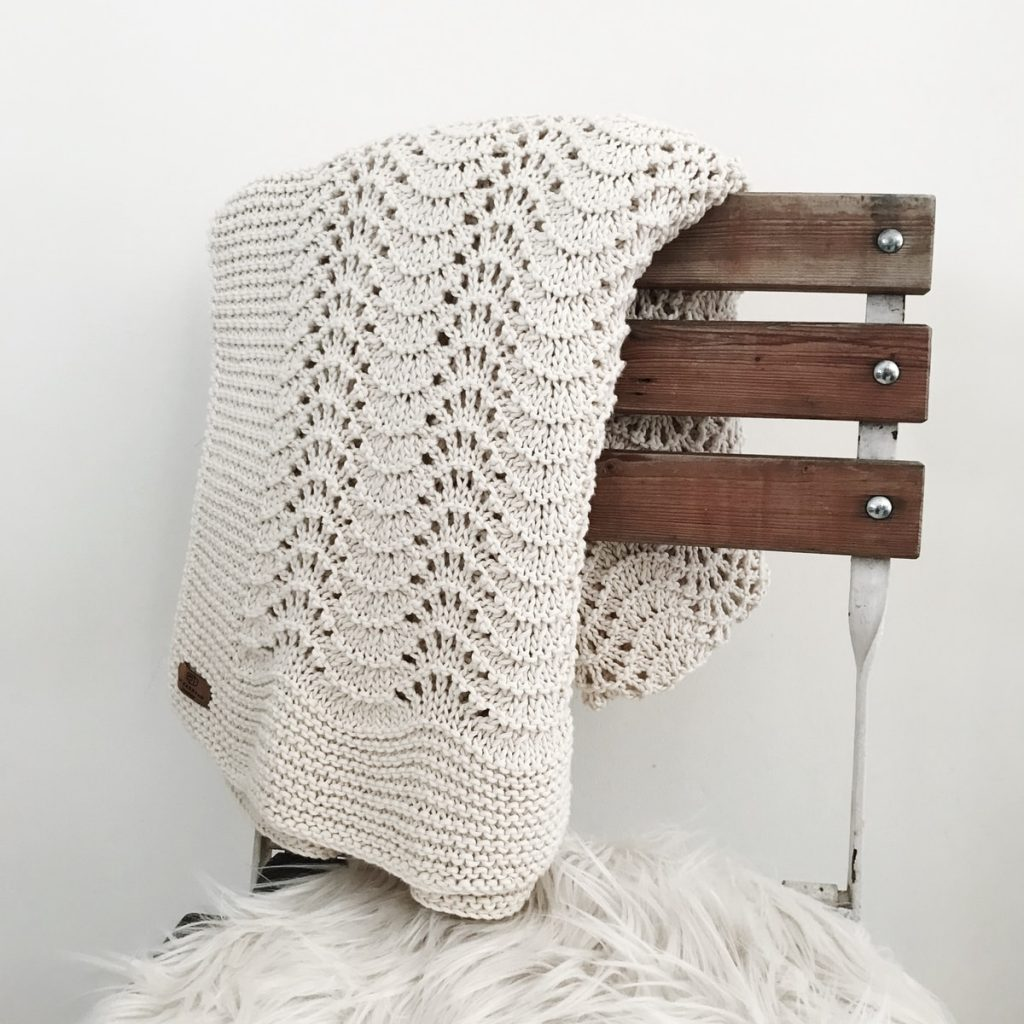 white knit textile on brown wooden chair