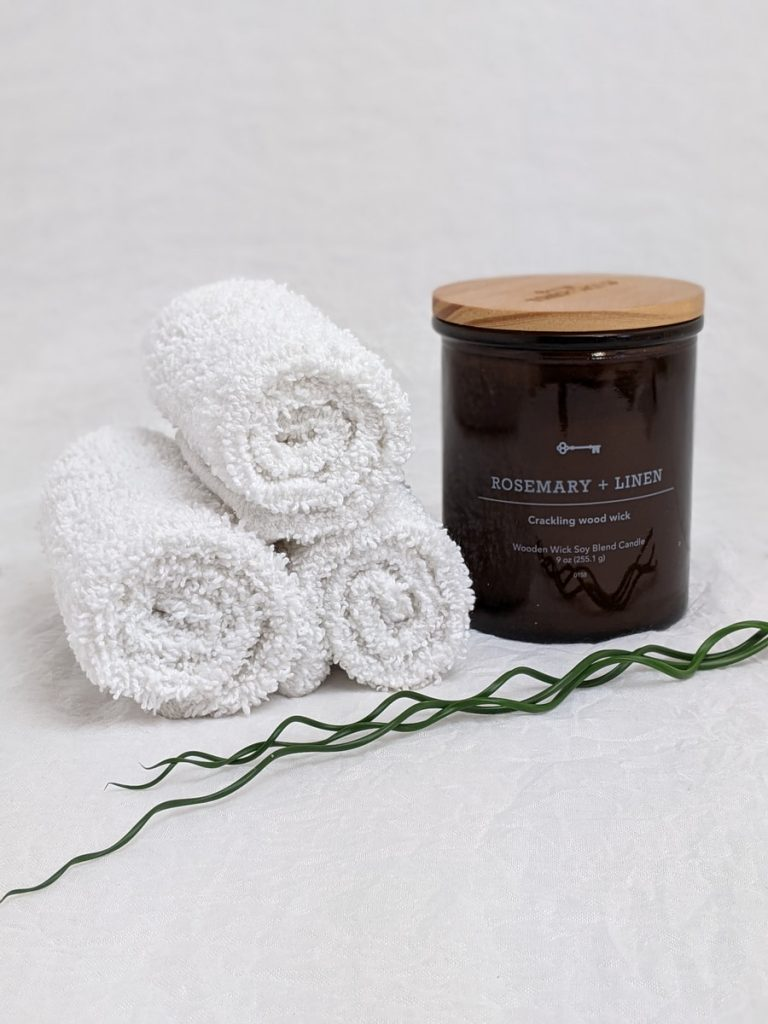 white fur textile beside black and brown ceramic mug