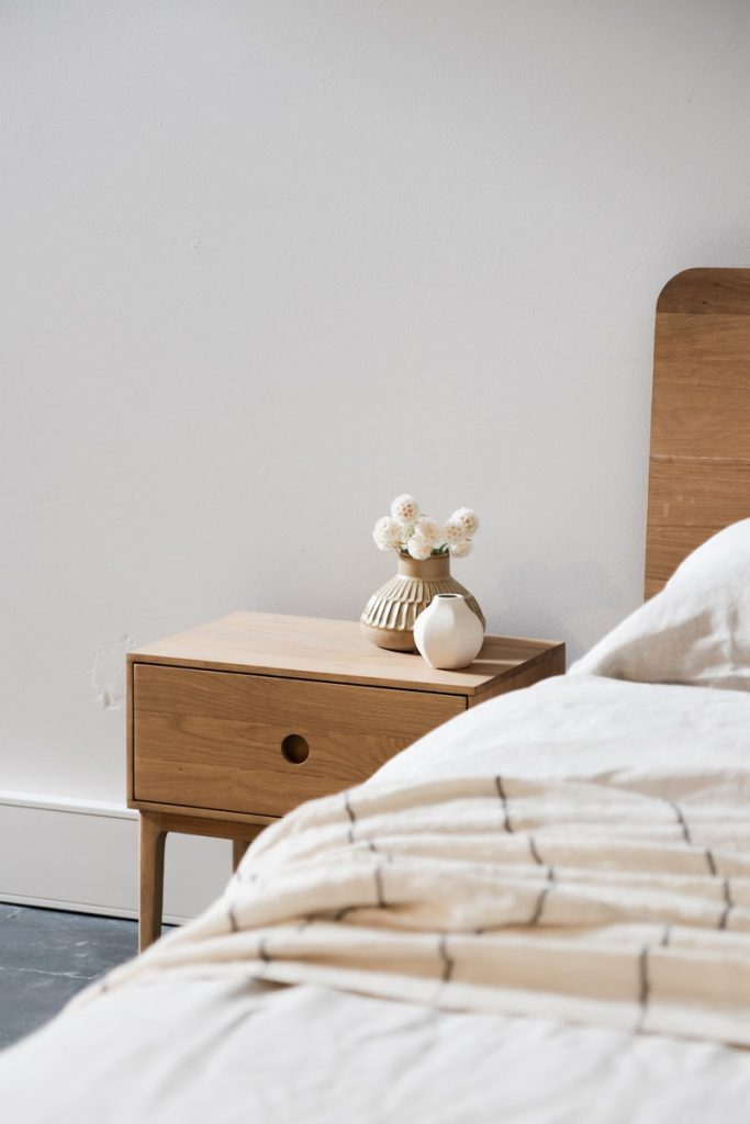 white ceramic rabbit figurine on brown wooden nightstand