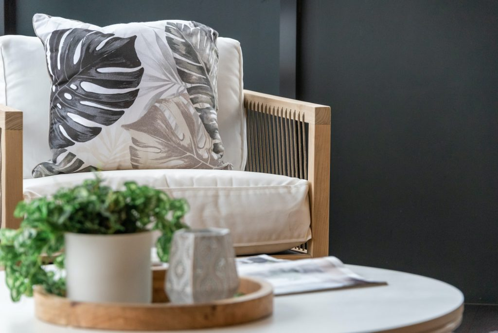 white throw pillow on white sofa chair